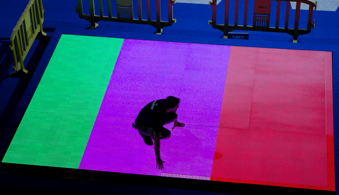 A worker at the CenturyLink Center makes final preparations for the spectacular light shows that will adorn the races at Trials (another shot from Tim Binning of TheSwimPictures.com)