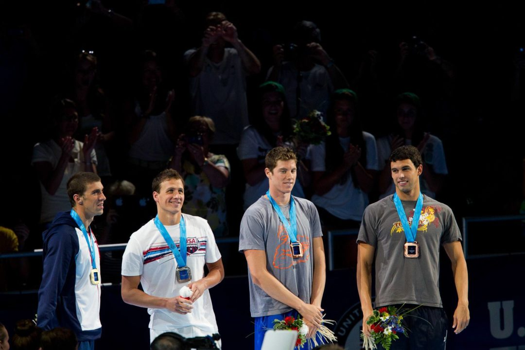 Phelps Anchors American Relay for First Gold Medal of Olympics