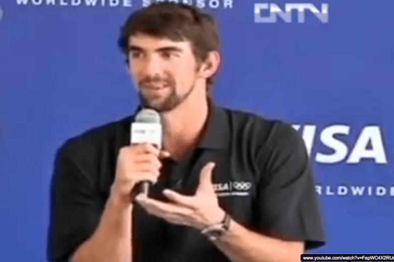 Michael Phelps Visits Slums of Rio to Promote 2016 Olympic Games