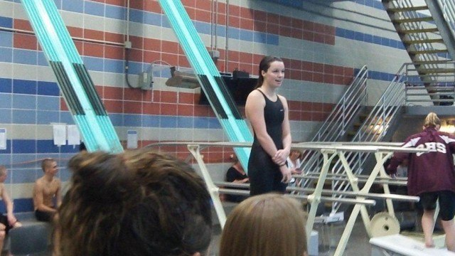 Hellen Moffitt of West Potomac accepts her award for winning the 100 fly in a new regional record time of 54.53. (Photo Courtesy: Matt Rees)