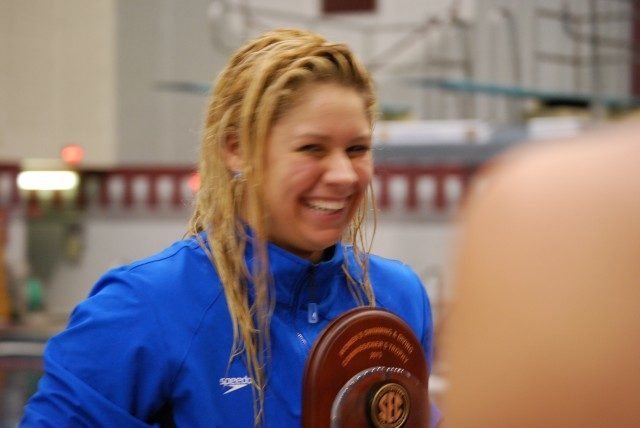 Elixabeth Beisel accepts the SEC Commissioners trophy as the highest women's point-scorer of the meet. Credit: Janna Schulze
