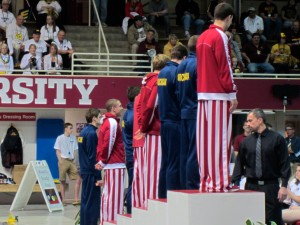 Indiana's Cody Miller atop the awards podium for the 200 IM