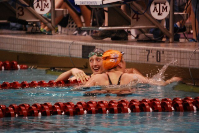 Larson and Tennessee's Molly Hannis, the runner-up, embrace after Larson's 100 breaststroke NCAA Record. Credit: Janna Schulze