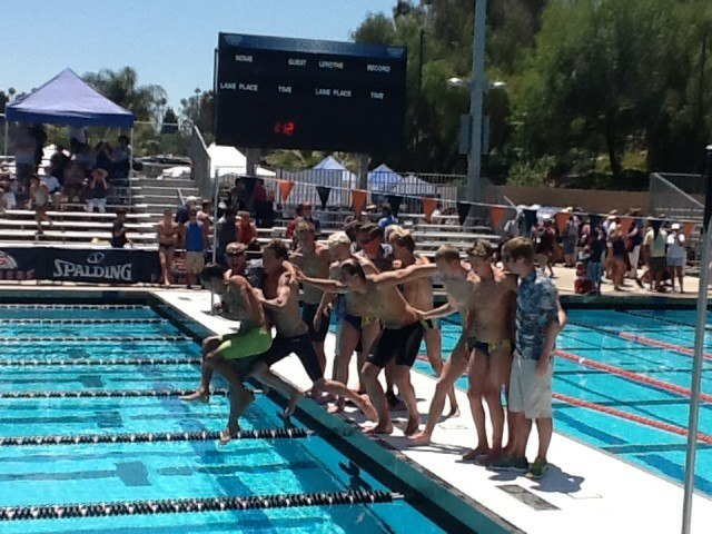 Los Osos takes the plunge after winning the Division II Boys' Championship. (Anne Lepesant.)