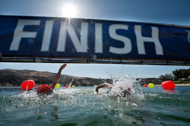 Knowing it can all come down to the touch - swimmers practice at the finish line
