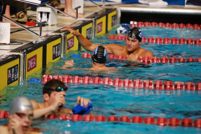 Two teammates congratulate each other after racing at the 2013 World Championship Trials. (Photo Credit: Janna Schulze, swimswam.com)