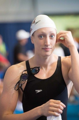 Class act. Breeja Larson heads to the blocks for the 100 breast prelims.  (photo: Mike Lewis, Ola Vista Photography)