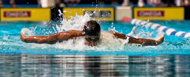 He's Phelps Fast.  Justin Lynch broke Michael Phelps 15 -16 national age group record in the 100 fly.  (photo: Mike Lewis, Ola Vista Photography)