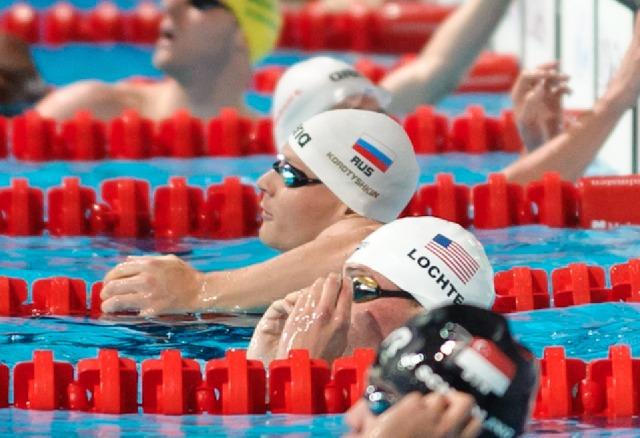 Pawel Korzenionski & Ryan Lochte, 100 butterfly prelim,  2013 FINA Worlds (Photo Credit Victor Puig, victorpuig.com)