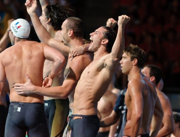 The French Team celebrates the men's 4x100 medley relay victory as Matt Grevers looks on...  2013 FINA World Championships (Photo Credit: Victor Puig)