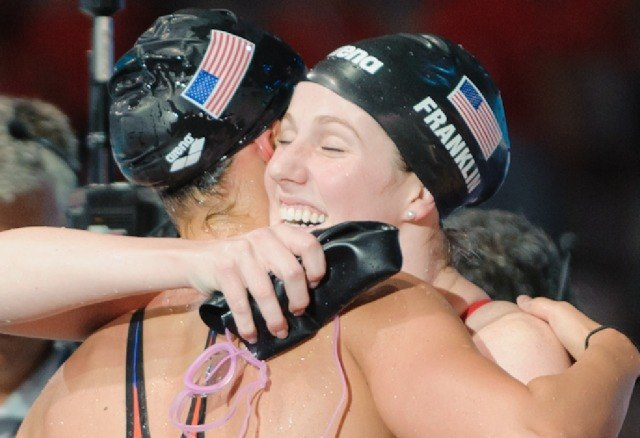 Missy Franklin hugs Megan Romano after winning the women's 4x100 medley relay victory,  2013 FINA World Championships (Photo Credit: Victor Puig)