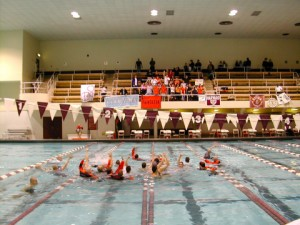 Princeton Tigers celebrating a conference victory in Harvard's pool (courtesy of SwimSrpay)