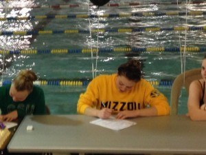 Erin Metzger-Seymour signs her National Letter of Intent for the University of Missouri. Photo courtesy of Erin Metzger-Seymour.