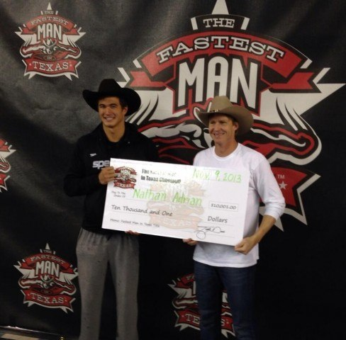 Josh Davis (right) presenting Nathan Adrian with his $10,001 check for being the Fastest Man in Texas.