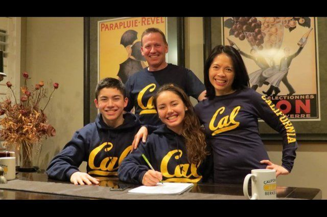Noemie Thomas of Canada signs her National Letter of Intent to swim for Cal, seen here with her family.
