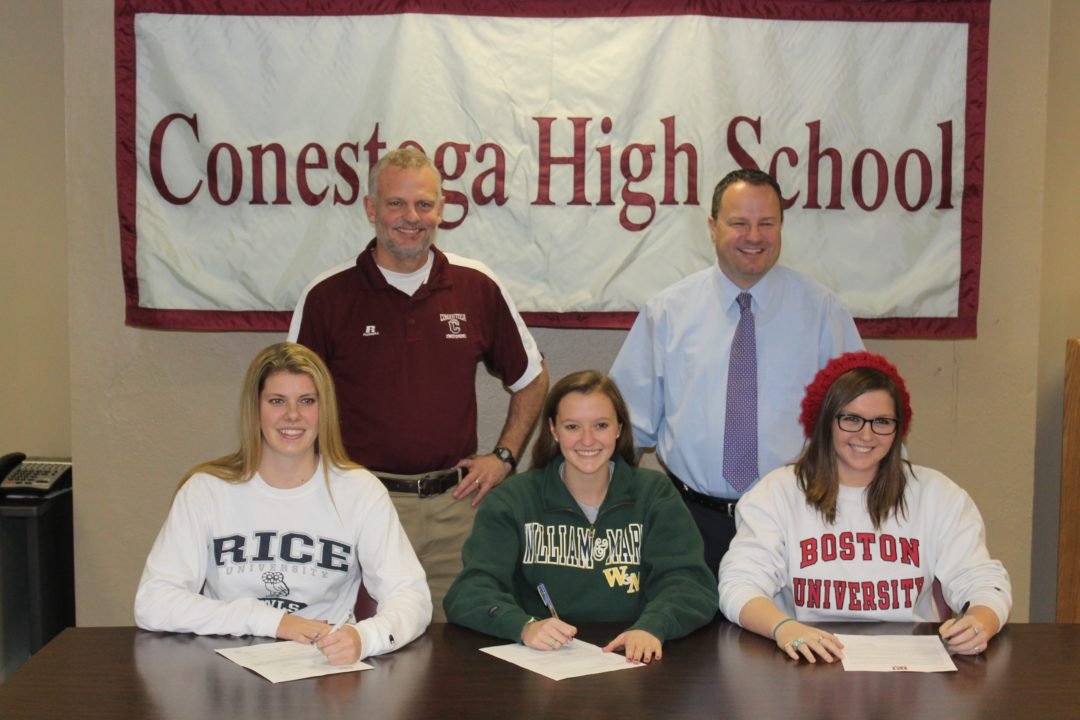(NLI Photos) 3 women from Conestoga High sign
