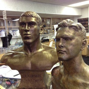 statues of Michael Phelps (left) and Adolph Kiefer (right) at the International Swimming Hall of Fame.