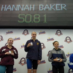 Hannah Baker takes the podium after her 100 freestyle win.