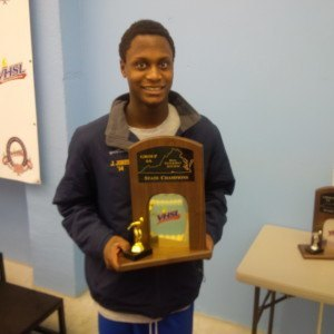 Robinson's James Jones shows off his team's state championship trophy.