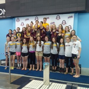 The state champion Oakton girls get together for a group photo.