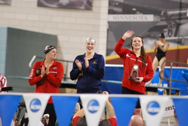 Brittany MacLean (right) beat Missy Franklin (center) and Amber McDermott (left) celebrate what was the best 500 free race in women's NCAA history.(Photo Courtesy: Janna Schulze)