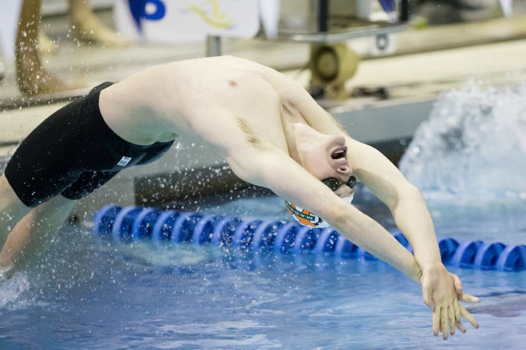 Conger Wins 200 Back as Texas Men Win 35th-Straight Conference Championship