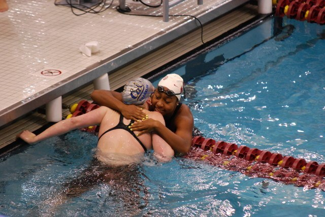 Olympic teammates Lian Neal (white cap) and Missy Franklin (gray cap) celebrate after the completing of the 400 medley relay. (Photo Courtesy: Janna Schulze)
