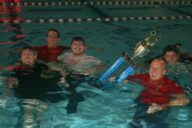 Phoenix Swim Club coaches celebrate their title. (Courtesy: Art Gramer)