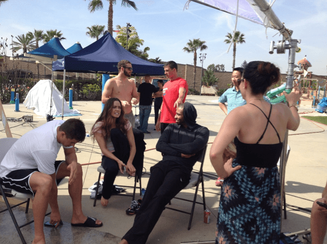 Team Speedo catches up during a break on set.
