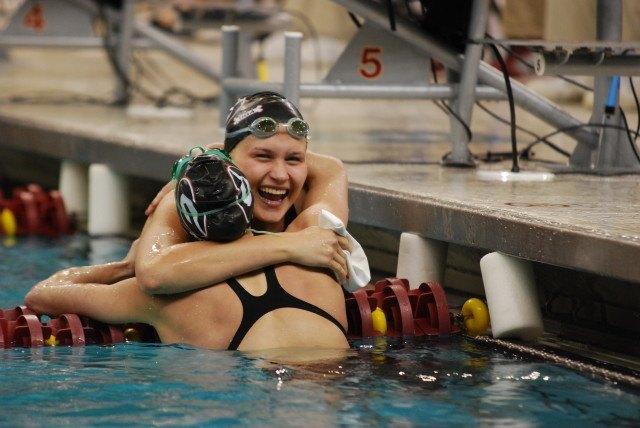Olivia Smoliga celebrates with teammate Maddie Locus after winning the 50 free. (Photo Courtesy: Janna Schulze)