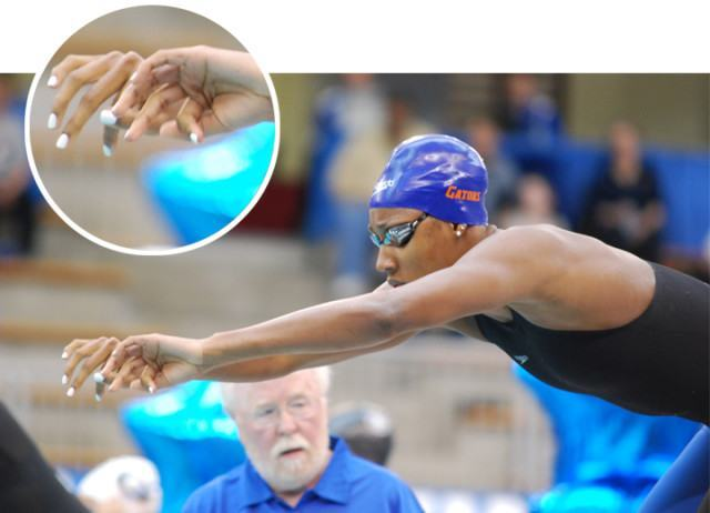 Florida sophomore sprint star Natalie Hinds prepares for a relay start with some fiece-looking white fingernails. (Courtesy: Janna Schulze)