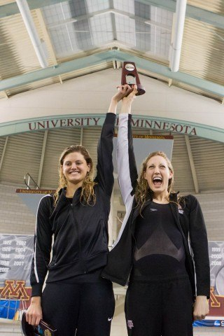 Texas A&M Senior Breeja Larson ® and Sophomore Ashley McGregor (L) celebrate a 2-4 finish for the Aggies in the 200 breaststroke at the 2014 Women's NCAA DI Swimming & Diving Championships (courtesy of Tim Binning, the swim pictures)