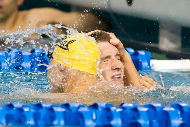 Ryan Murphy of Cal, the 100 backstroke winner, is congratulated by teammate Tony Cox who placed seventh at the 2014 NCAA Division I Swimming and Diving Championships. (courtesy of Tim Binning, theswimpictues)