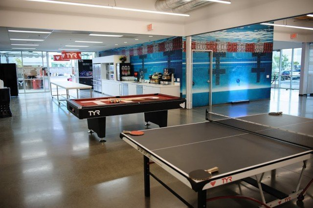 Employees can take a break by shooting pool, playing ping pong or snacking in the state-of-the-art kitchen.  TYR Sport Global Headquarters, Seal Beach, CA (courtesy of TYR Sport)