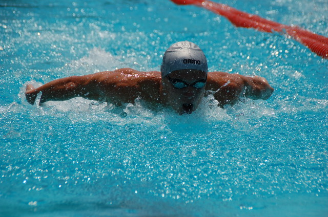 Kyle Coan won the 100 fly. Photo: Anne Lepesant
