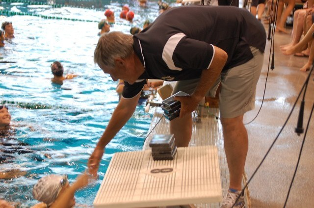 This guy was busy handing out medals for three days. Golden West College head coach Mark Schubert. Photo: Anne Lepesant