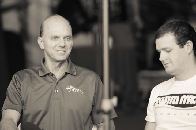 Rowdy Gaines chats it up with Tyler Clary before the start of finals (photo: Mike Lewis, Ola Vista Photography)