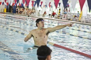 Mark Gangloff gives some in-the-pool instruction.