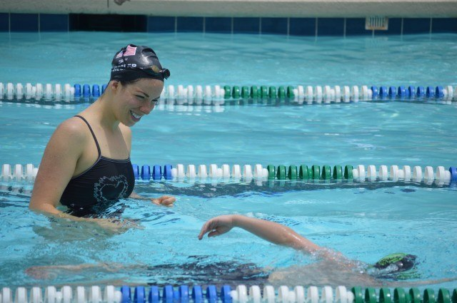 Kate Ziegler watching participants practice freestyle drills - Fitter and Faster Swim Tour Greenville, SC Clinic