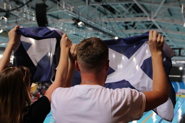 Scottish Fans celebrate their team's success at the 2014 Commonwealth Games (Courtesy: Markus Stitz/Scottish Swimming)