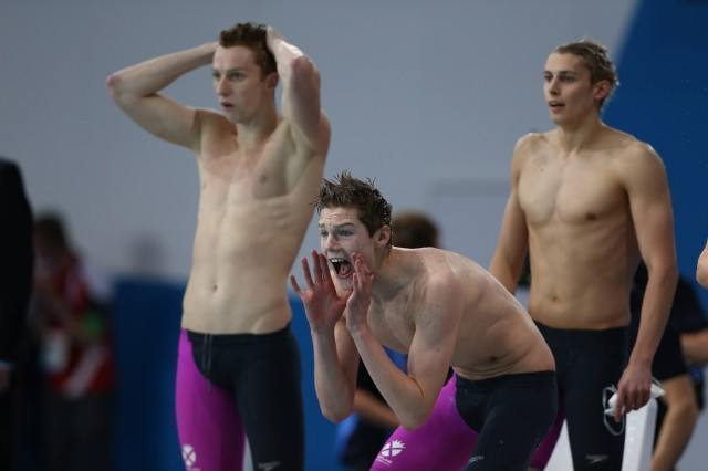 Members of the Scottish 4x200 free relay urge their teammates on. Courtesy of Scottish Swimming.