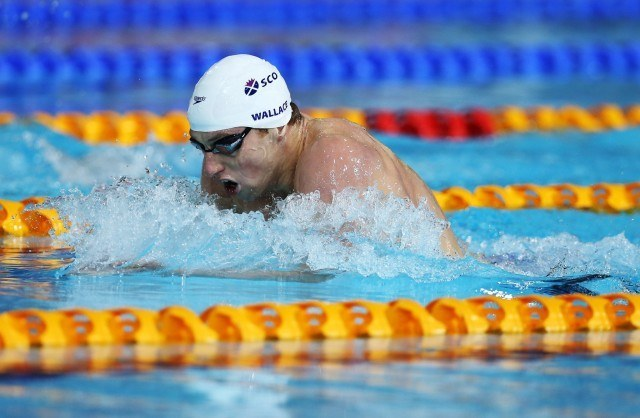 Dan Wallace en route to a  surprise 400 IM gold medal on Friday at the 2014 Commonwealth Games (courtesy: Ian MacNicol/Scottish Swimming)