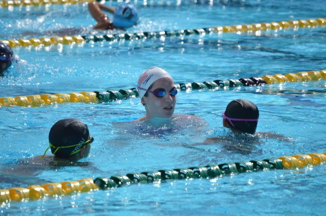 Kara Lynn Joyce giving participant feedback at the Fitter and Faster Swim Tour in Yucaipa, CA.