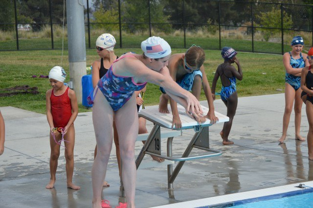 Kara Lynn Joyce helps participants with start technique - the Fitter and Faster Swim Tour in Yucaipa, CA.