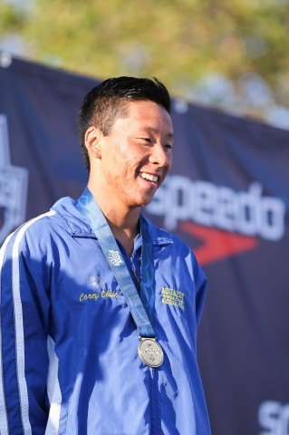 Corey Okubo accepted a well-earned medal from an impressive 200 fly win.