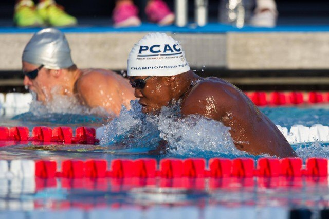 Michael Andrew (background) and Reece Whitley (foreground) battle in the outside lanes of the boys 100 breaststroke B-Final.