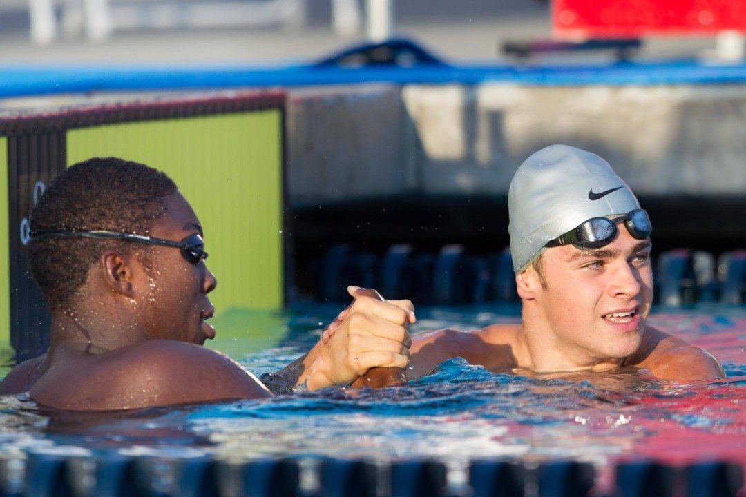 Reece Whitley and Michael Andrew Swim Side-by-Side for History