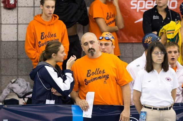 Daddy shark, Bolles Sharks coach Sergio Lopez, assists his swimmers in developing their sharkiness. (Courtesy: Tim Binning/TheSwimPictures.com)