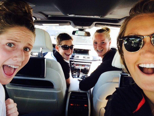 Caitlin Leverenz taking Katherine Breed, Missy Franklin, and Liz Pelton for a ride in her new BMW. (Photo Credit: Liz Pelton)