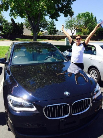 Caitlin Leverenz with her 2014 Grand Prix Series prize, a brand new BMW! (Photo Credit: Liz Pelton)